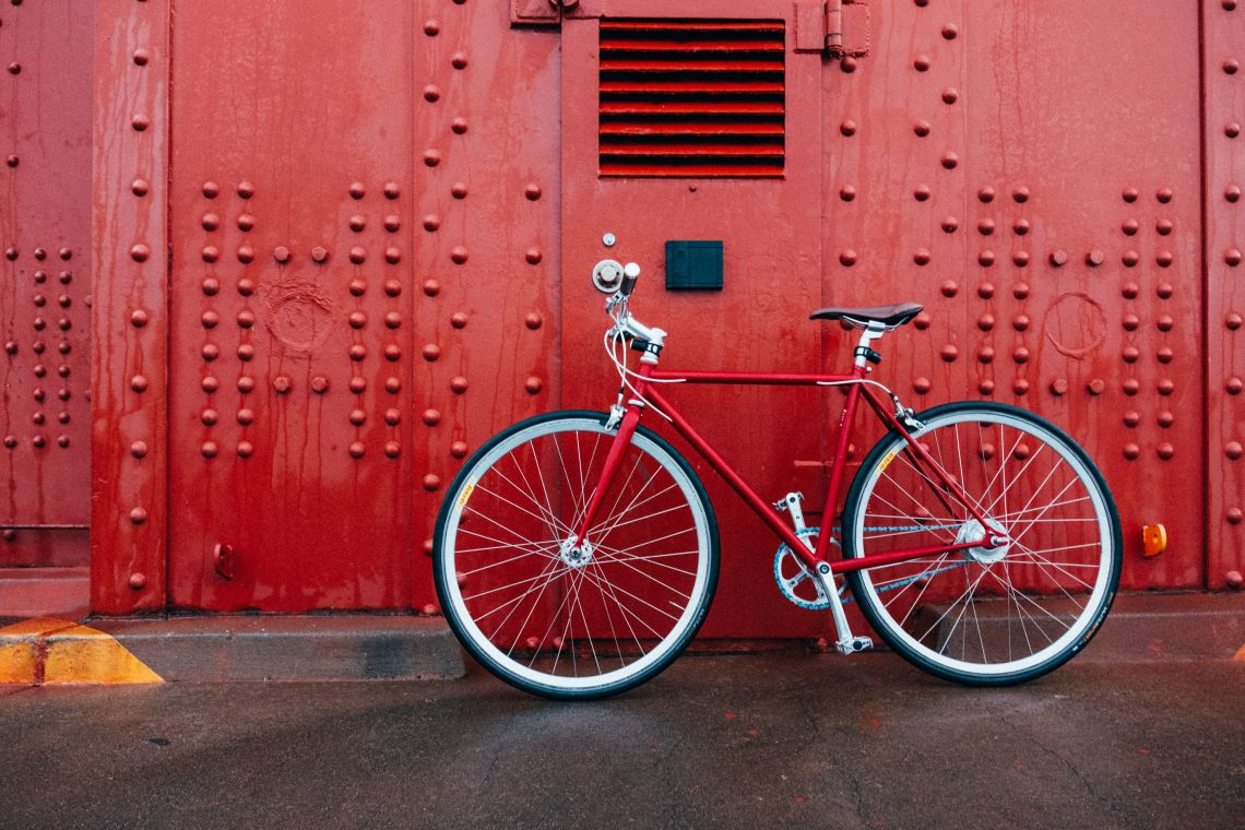 Bike on red background - The rise of cycling culture