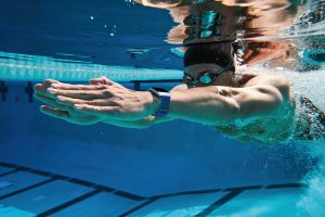 Lifestyle photo of Male Swimming Outdoors with Ionic Cobalt/Lime Sport Band